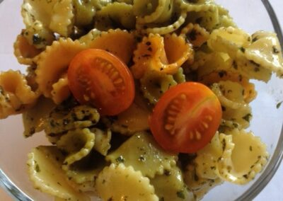Tricolor pasta salad with cherry tomatoes and pesto