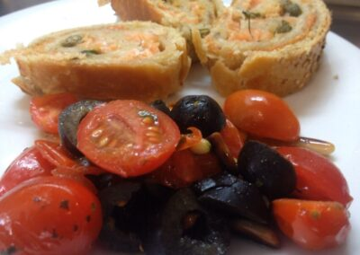 Smoked salmon rolls, with tomatoes cherry salad , green olives and pine nuts